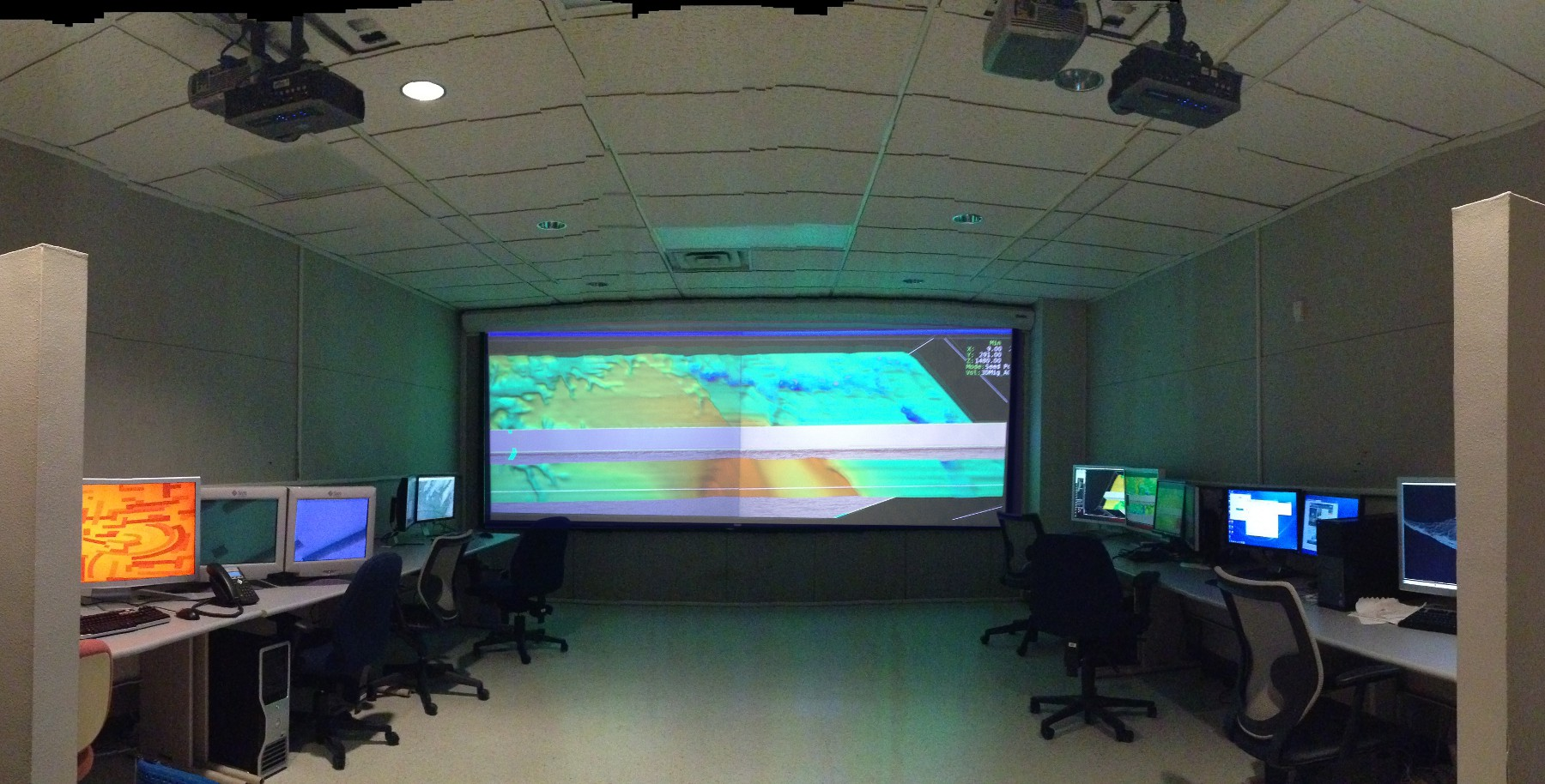 STARR Visualiztion Lab with four projectors on double wide screen and workstations.